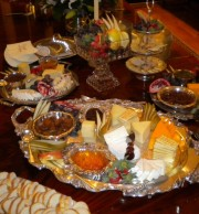 This spectacular display of specially made condiments, local honey with imported, local, and domestic cheese, fruit, crackers and bread makes a party in and of itself.
