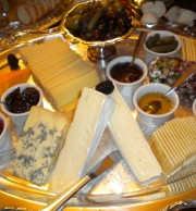 Cheese Display with Little Ramekins of Local Honey, Homemade Chutney, Preserves, Dried Tomatoes, and Marinated Olives