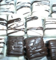 Caramels in chocolate made one at a time.